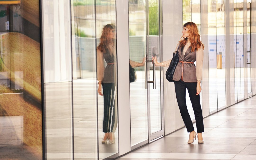 Woman opening the door to her new employer, onboarding and career success beckon